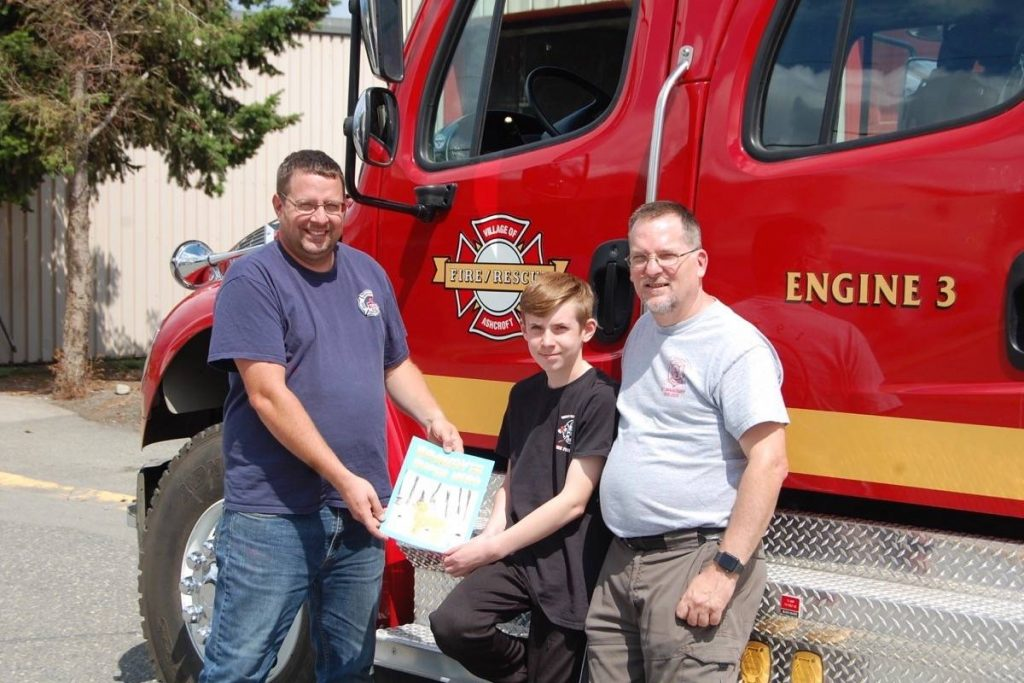 (from left) Ashcroft fire chief Josh White, Nathan McTaggart, and Keven McTaggart outside the Ashcroft fire hall on July 7. Photo: Barbara Roden